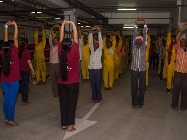 yoga with laborers